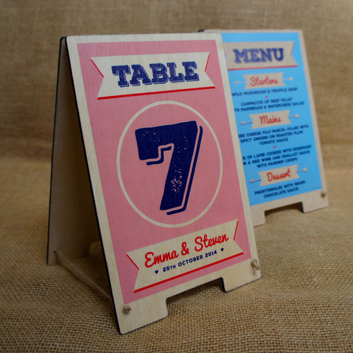 Ideal for weddings and events, these small tabletop wooden signs act as both a table number/name sign and also display your menu as well.  Made from 4mm birch ply your event information can be printed onto the wooden boards.