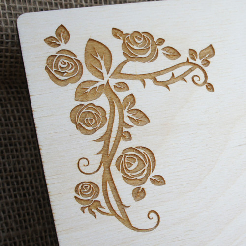 Close up of an engraved corner of a Wooden Wedding Table Plan - Wild Rose (Curved Top)