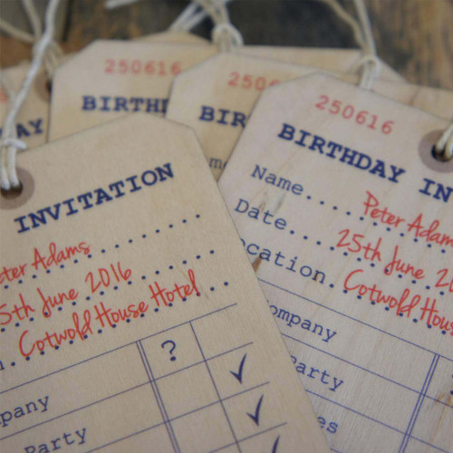 Printed wooden invitation tags.