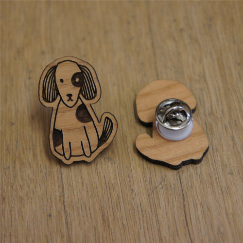 Engraved wooden badge / pin/ brooch of a cute dog.