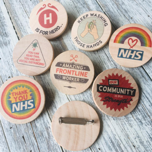 Wooden Badges with coronavirus themed designs - 25% of the total costs go to NHS charities.