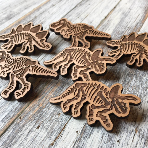 Engraved Wooden Dinosaur badges - choose from either a Tyrannosaurus Rex, Triceratops , Stegosaurus or all three!