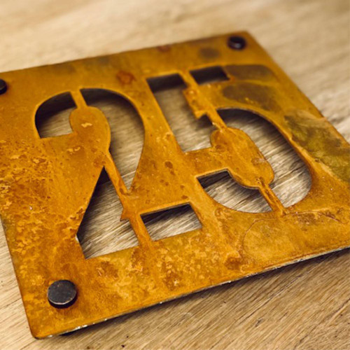 Corten steel house number sign. rusty metal house number plaque.