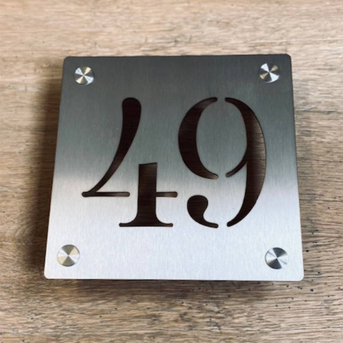 Stainless steel house number sign on optional stand off fixings.