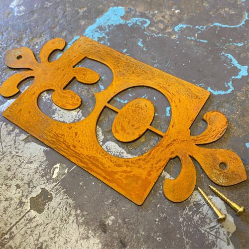 Corten steel house number sign with fleur de lys styling. rusty metal house number plaque. Fleur de lis sign.