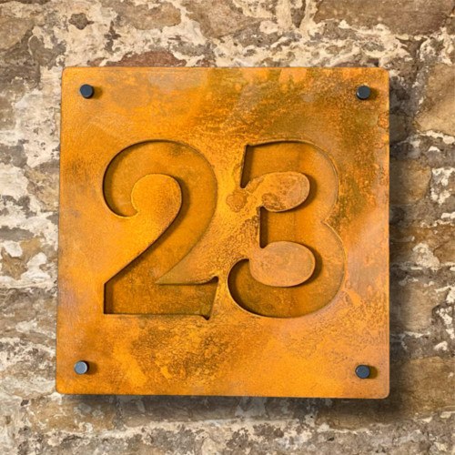 Square rusty steel house number sign with Corten steel backing plate