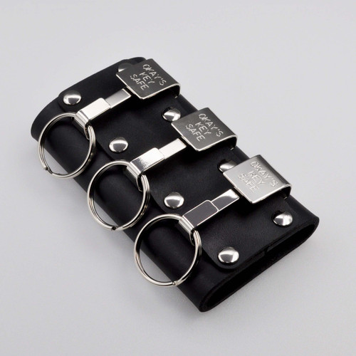 """Okays Ultimate Key Keyper Nickel Plated Triple Key Safe Belt Key Holder. Fits belts up to 2-1/4"""" wide.  Belt is needed to use. Top grain dyed heavy duty leather holder. Made in the USA. Popular with police, security guards, correctional officers and janitors.  Three Okays nickel plated"""