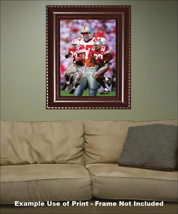 Ohio State Buckeyes Eddie George Running Back framed on wall with sofa