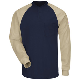 Bulwark Long Sleeve CAT 2 FR Henley Shirt - Front view of Navy and Khaki Bulwark long sleeve shirt with three buttons going down the front and a pocket on the left side of the chest. There is also a Bulwark logo on the left arm. The body of the shirt is dark blue and the arms are white.