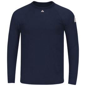 Bulwark 8.75 oz FR Tagless CAT 2 Long Sleeve T Shirt - Navy blue Bulwark long sleeve Tagless shirt with cuffs and trim collar. With left arm and front patches. Pocketless. Front view.