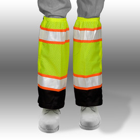 ML Kishigo Class E Zipper with Hook and Loop Mesh Gaiters - Front View of Yellow Hi-Viz Leg Gaiters on a persons legs with silver on orange reflective stripes at the top and bottom. Bottom quarter is black with hook and loop for boot access. Zipper closure.