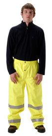 Nasco Class E Hi Visibility Yellow Rain Pants - Young Man wearing a NASCO black shirt and yellow rain pants with 2 reflective tape around each leg