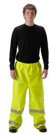 Nasco FR Class E Yellow Rain Pants - Young Man wearing a NASCO black shirt and yellow rain pants with 2 reflective silver stripes around each leg below the knee