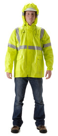 Nasco Class 3 FR  Yellow Rain Jacket - Yong guy wearing a NASCO Yellow Rain Coat with silver reflective tape around both arms and around waist and a hood