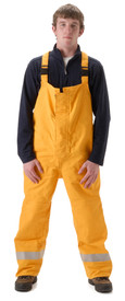 FR CAT 2 Chemical Splash Rain Bib Overall - Front View of Young Man wearing a NASCO orange rain bib overalls with reflective tape round the ankles of both legs