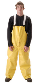 Nasco Yellow Snap Fly Front Bib Overall  - Young Man wearing a NASCO yellow rain bib overalls and black shirt