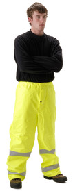 Nasco Sentinel FR High Viz Rain Pants - Young Man wearing NASCO yellow rain pants with 2 silver reflective tape around both legs below the knee
