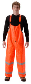 Nasco Hi Viz Orange Rain Bib Overall CAT 2  - Young Man wearing NASCO orange rain bib overalls with 2 silver reflective tape around both legs below the knee
