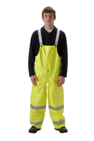 Hi-Viz Rain Bib Overall by Nasco - Young Man wearing a NASCO black shirt and yellow rain bib overalls with straps and 2 reflective tape around each leg below the knees