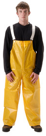 NASCO Lightweight Waterproof Bib Overall - Front View of Young Man wearing a NASCO yellow rain bib overall with white suspenders