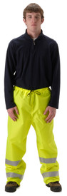 NASCO Yellow Hi-Viz Rain Pants - Young Man wearing a NASCO yellow rain pants with 2 reflective tape around each leg below the knee