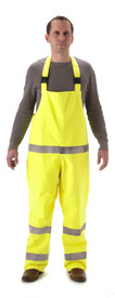 Rampart Premium FR CAT 2  Nasco Rain Bib Overall - Front view of man wearing a NASCO yellow rain bib overall with 2 reflective tape around both legs and around the waist