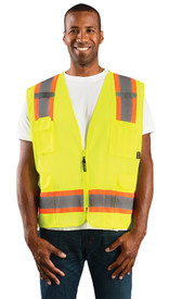 Occunomix Class 2 Mesh 2 Tone Surveyor Safety Vest - Front view of man wearing Occunomix yellow high visibility mesh safety vest with zipper front closure, silver on orange reflective horizontal tape around lower vest and silver on orange reflective tape up right and left sides and over shoulders, 1 large pocket on upper left side, 1 radio  pocket on upper right side and 2 large pockets with flaps on lower right and left side.