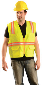 Occunomix NON-ANSI Solid 2 Tone Surveyor Safety Vest - Front view of man wearing Occunomix yellow high visibility solid safety vest with zipper front closure, silver on orange narrow width reflective horizontal tape around vest and silver on orange narrow width reflective tape up right and left sides and over shoulders,  1 lower pockets with flaps on right side, 1 lower pockets with flaps on left side, pockets with pen compartments on upper right and upper left sides.