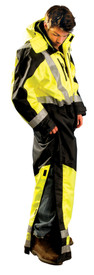 Occunomix Class 3 Winter Insulated Hi-Viz Coverall - Side view of  Occunomix yellow and black high visibility coverall with zipper front closure, full length size zipper legs, hood, 1 silver reflective tape placed horizontally around mid section, 1 silver reflective tape placed on both arms at wrists, silver reflective tape place vertically on front and over both shoulders and 2 silver reflective tape placed on both legs around ankles.