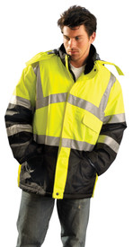 Occunomix Class 3 Insulated Waterproof Winter Parka - Front view of  man wearing Occunomix yellow and black bottom high visibility Jacket with zipper front closure, storm flap, 2 lower pockets, mid section left front pocket with flap, 2 silver reflective tape placed on both arms below and above elbows, silver reflective tape placed horizontally around coat mid section,  silver reflective tape placed around waist and silver reflective tape placed vertically going up front of both sides of coat and over shoulders.