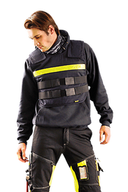 Occunomix FR Insulated Reflective Phase Change Cooling Vest - Front view of man wearing Occunomix Cooling Vest with yellow reflective tape going horizontal across the top of the vest. 2 straps go around the vest and connect in front below the yellow tape. 4 inch wide shoulders attach to the vest front with Velcro.