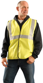 Occunomix Class 2 FR CAT 1 Solid D Ring Safety Vest - Man wearing Occunomix High visibility yellow solid vest with hook & loop closure, lower right outside pocket, silver reflective tape placed horizontal around vest at mid section and silver reflective tape going up the front and over both shoulders