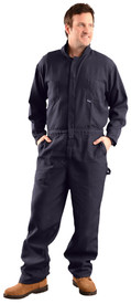 Occunomix Nomex Flame Resistant CAT 1 Navy Coveralls - Man wearing Occunomix Navy blue flame and chemical resistant coveralls with elastic waist,2 front chest pockets, 2 lower front pockets, zipper front, storm flap and collar.
