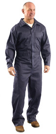 Occunomix Flame Resistant CAT 1 Work Coveralls - Man wearing Occunomix Navy blue flame and chemical resistant coveralls with elastic waist,1 front chest pockets, 2 lower front pockets, zipper front, storm flap and collar.