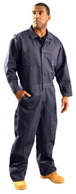 Occunomix Flame Resistant CAT 2 Indura Work Coveralls - Man wearing Occunomix Navy blue flame and chemical resistant coveralls with elastic waist,2 front chest pockets, 2 lower front pockets, zipper front, storm flap and collar.