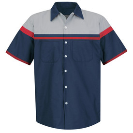 Red Kap Men's Automotive Tech 2 Pocket Shirt - Red Kap navy short sleeve performance tech work shirt with collar. 6 inch wide band of grey material across the chest up to the navy collar, a thin blue and a thin red band of material beneath the wide grey band and a red band outlining the grey band on the sleeves and a thin red band on the edge of each sleeve. Shirt has 7 button front closure and 2 navy chest pockets with no buttons. Front View