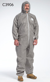 PIP Gray SMMMS Elastic Wrist Coverall - Man wearing gray safety coverall with attached hood and elastic wrists and ankles.