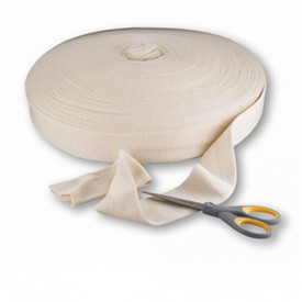 PIP Tubing Rolls - Large roll of cotton tubing with one end draped to show texture, with scissors to show scale.