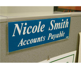 Acrylic Office Cube Partition Sign Holders - Aris Industrial Acrylic office partition sign holder resting on top of office partition.