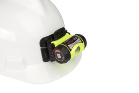 UK Helmet Mount 3AAAeLED Light - Yellow headlamp flashlight with black ends. Shown clipped to a white hardhat with an adjustable black mounting clip.