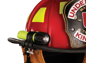 UK Nitex Pro GFN Traditional Helmet Clip - Red fire fighter hard hat with black and yellow flashlight on brim attached by black holder with two metal adjusters.