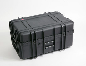 UK 1327 LoadoutCase Protector - Large size hard black plastic transit case with ridges, side handles, and large main handle, shown closed.