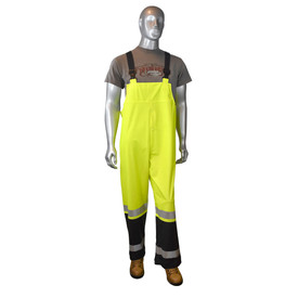 Radians Fortress 35 Class E Hi-Viz Rain Bib Overall - mannequin wearing Radians grey shirt and brown shoes over Radians black and yellow hi-visibility rainwear bib coverall with reflective tape on ankles are.