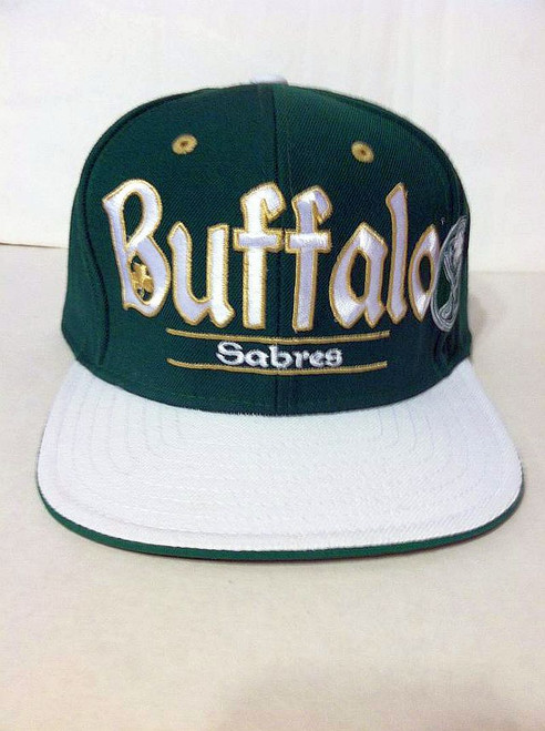 Color: Green & White  One Size Fits Most  Snap Back Plastic Adjustable Strap  Embroidered team logos on the front  Six Panel Structured fit / Flat bill  Design Has Been Retired and is No Longer Available  Official NHL licensed product  Item #:4959-2 © NHL