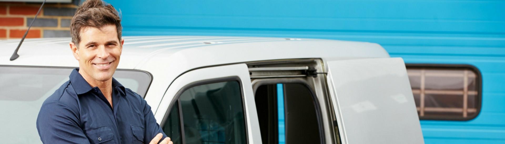 Sign Repair Technician In Front of Service Van