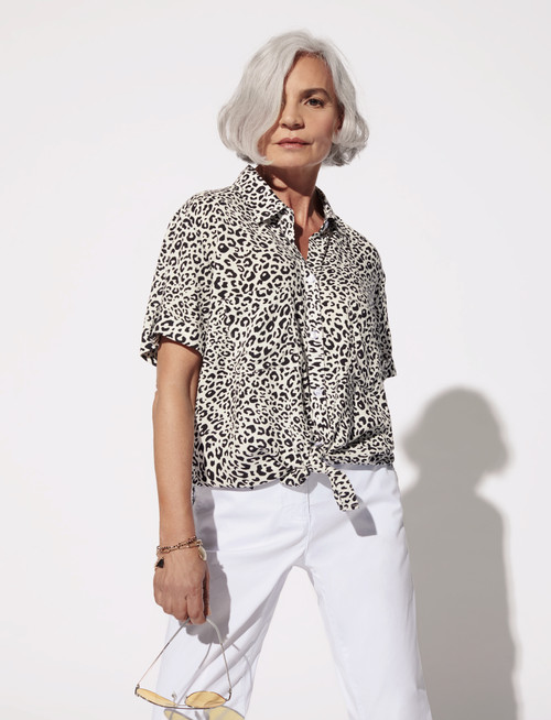 Black and white leopard print blouse with longer hem in back