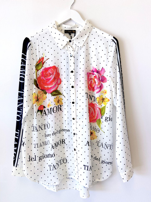 Black and white polka dot blouse with flowers and rhinestone details