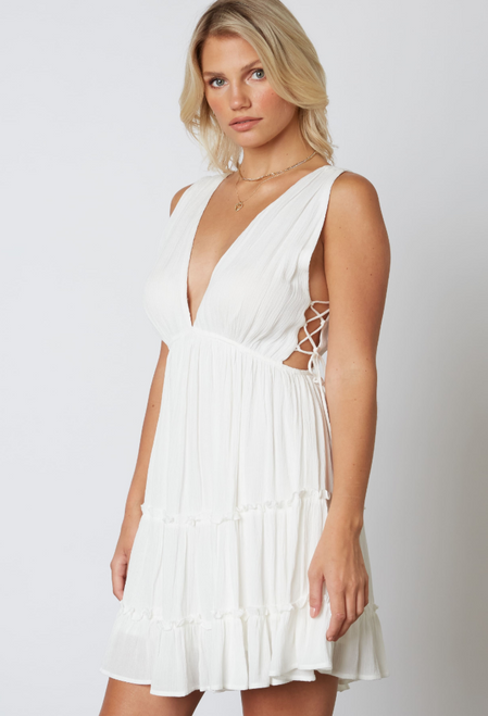 Women's white dress featuring low back, plunging neckline and lace up sides