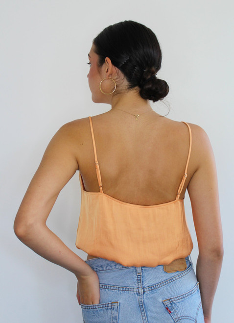 Women's tangerine v neck crop top with adjustable straps and elastic band