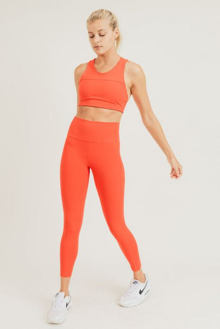 Women's orange sports bra with removable padding